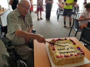 Deputy Chair of Council's Disability Inclusion and Access Committee Peter Dickson-Smith cutting the IDWPD cake.