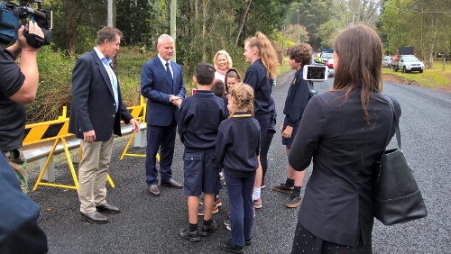 Deputy Prime Minister Michael McCormakc, Luke Hartsuyker and the Mayor chat to Crossmaglen Public School students after opening Bardens Bridge.