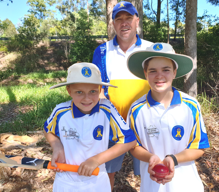 Chris Neal, President Sawtell Cricket Club with members Asha Lloyd and Finn Helliwell.