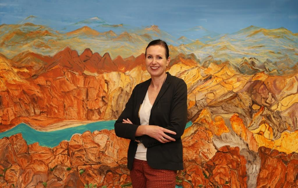Dr Rebecca Coates in front of Angelina Gorges painting in SAMs collection.