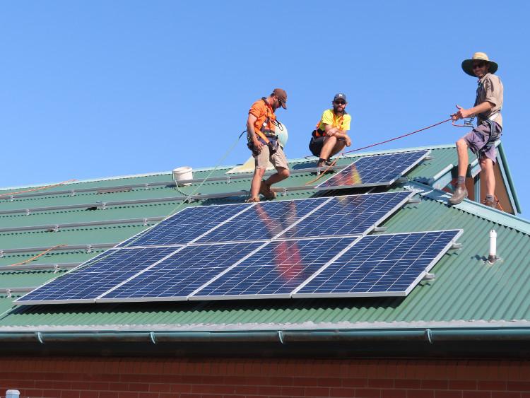 Solar Depot staff installing panels on Woolgoolga Library
