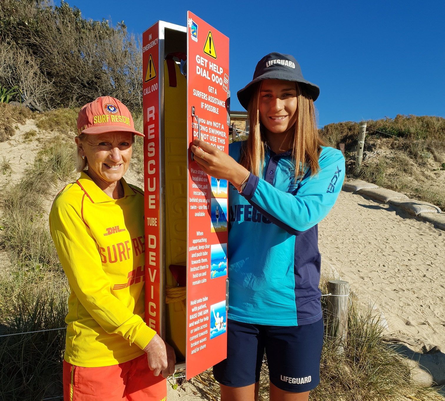 Rescue Tubes - Sheena McTackett, President of the Sawtell SLSC, and Maddi Carah, CHCC lifeguard