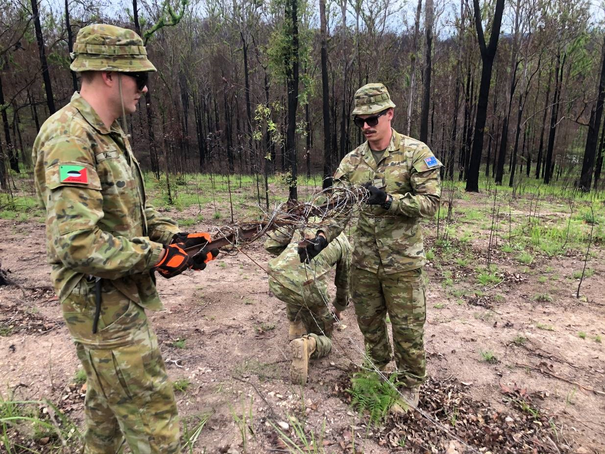 Soldiers from 41 Battalion, Royal New South Wales Regiment, helping in the bushfire recovery effort in Nana Glen.